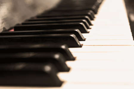 Close up piano keys black and white in light sepia Stock Photo - 114742287