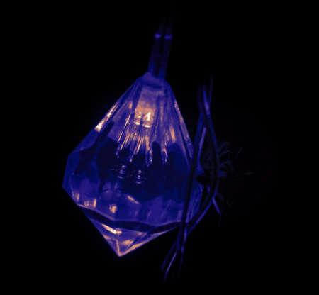 Geomethric dark blue light from Christmas tree lights in dark Stock Photo