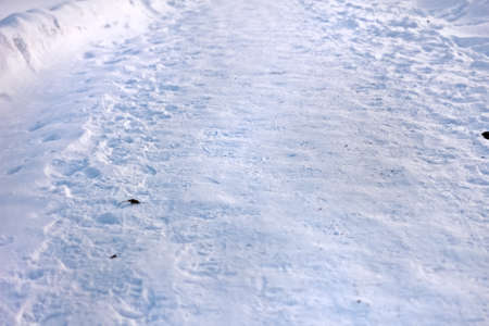 Usual trampled snow road at winter weather day Stock Photo - 114742290