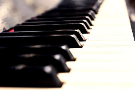 Close up piano keys black and white in light little sepia
