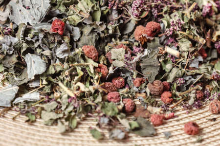 Dry herbal tea with raspberry berries for tasty good mood party and health