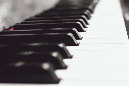 Close up piano keys black and white in light soft milk sepia Stock Photo