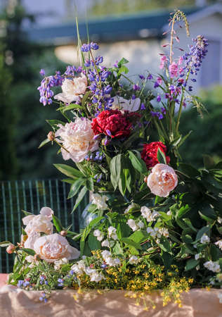 Beauty summer bouquet with peonies and other flowers Stock Photo