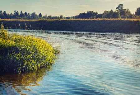Beauty turning river on sunny summer evening