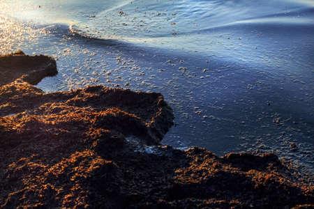 April Baltic sea coast at sunset for romantic mood