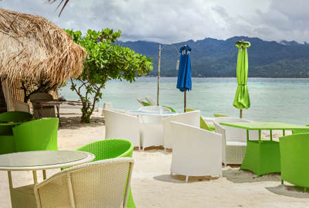 Real deserted cafe on beach at sunny day Stock Photo