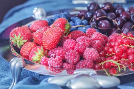 Charming fresh berries on silver platter for tasty eating