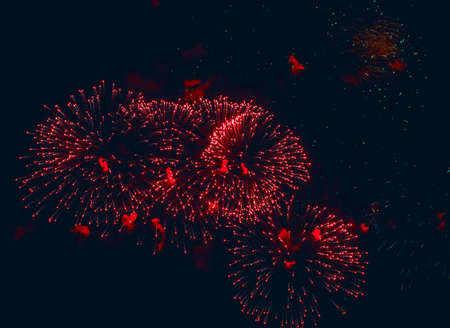 Big red volleys of fireworks in dark sky Standard-Bild