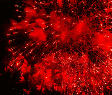 Big spray of red fireworks on black background
