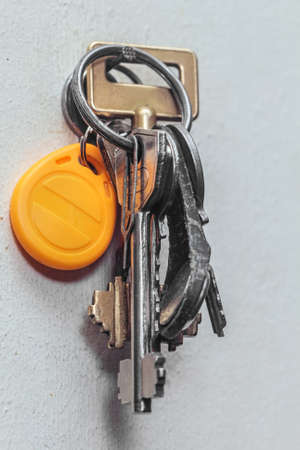 Real bunch of keys hanging on nail for comfort life Stock Photo