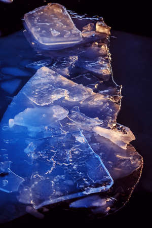 Real beautiful ice floes in winter dark water like charming brilliance
