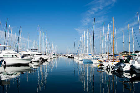 View on  Saint Tropez harbour with white yachts and boats on a beautiful sunny day