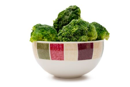 frozen broccoli in a bowl on white background photo
