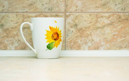white cup on the background of marble tiles photo