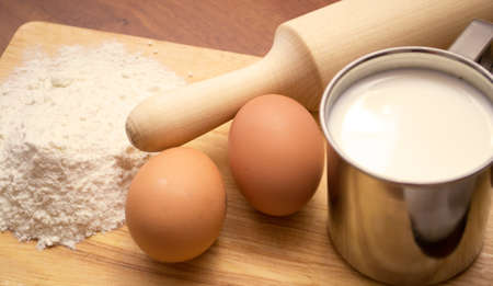 cup of milk, flour and two eggs photo