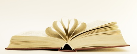 prose: an open book lying on the table Stock Photo