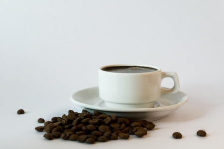 a white coffee cup and saucer photo