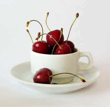 Still life cherry in a white cup photo