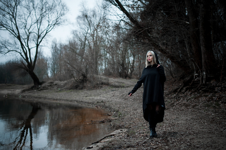 gothic girl: Shot of a gothic woman in a forest. Fashion.