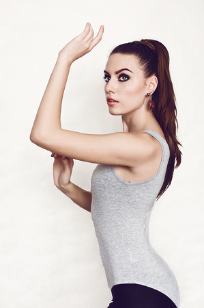 pony tail: A young and fit woman with a pony tail  black tights  tank-top Stock Photo