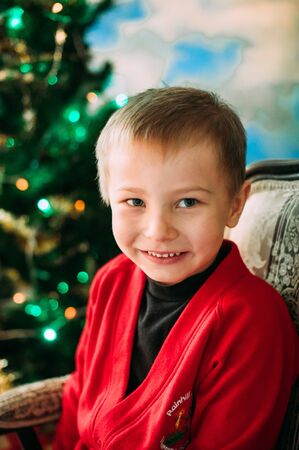 Portrait of adorable boy with giftboxes