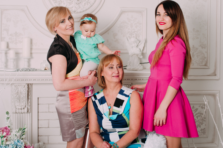 three generations of women: Happy family of women, three generations . Fashion style studio portrait.