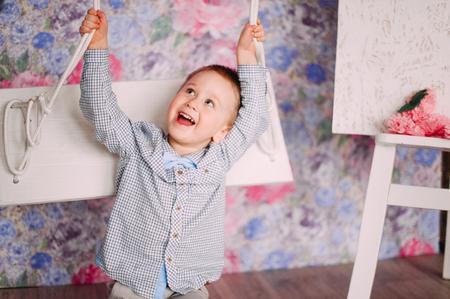 6 12 months: Laughing Baby Boy having fun