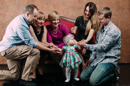 three generation: Three Generation Family Sitting On Sofa Together. Classic portrait