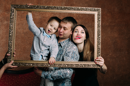 Three Generation Family Sitting On Sofa Together. Classic portrait in a frame