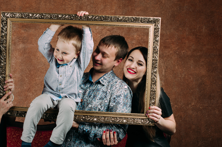three generation: Three Generation Family Sitting On Sofa Together. Classic portrait in a frame