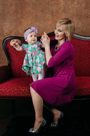 grandaughter: Portrait of a grandmother and her eight month old grandaughter