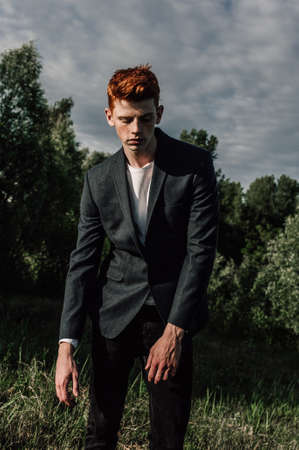 dimple: Portrait of attractive stylish young guy model with red hair