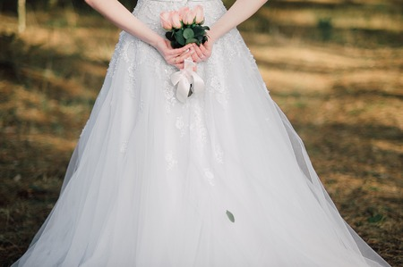 arm bouquet: Back of beautiful bride with bridal bunch Stock Photo