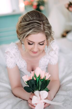 Portrait of bride in flower decor, studio photo. Beautiful Bride portrait wedding makeup and hairstyle, fashion bride model jewelry and beauty girl face, gorgeous beauty bride, studio, flower series Stock Photo