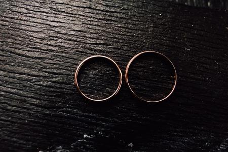 customary: gold wedding rings on the pincushion