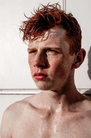 Portrait of attractive stylish young guy model with red hair