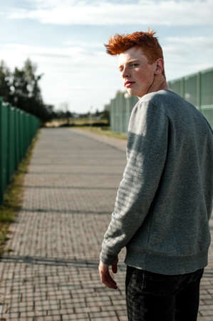 dimple: Stylish young attractive man with red hair