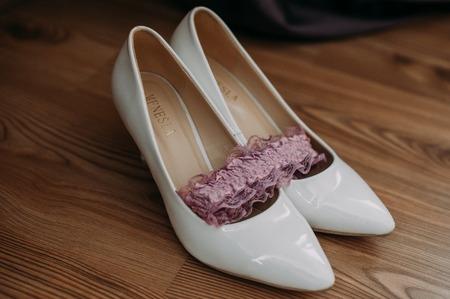 Bride accessories: lace blouse, garter, ballet flats, high-heeled shoes