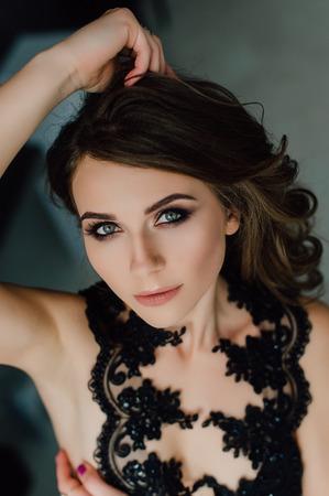 retouched: Individuality. Thoughtful Elegant Lady in Black Prom Evening Dress. Studio retouched photo.