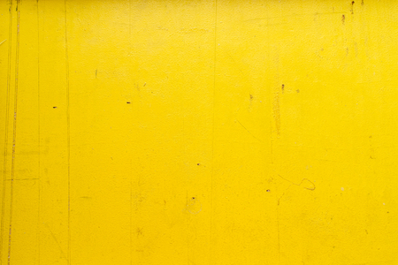 Old painted yellow wood background texture.