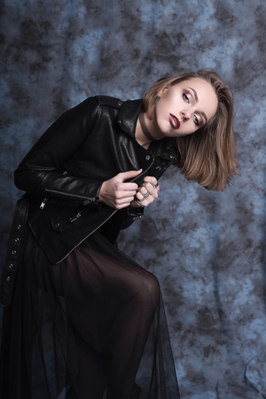 hands in pocket: High fashion look, glamor stylish beautiful young woman model with red lips in hipster rock black cloth in boots. Retouched shot Stock Photo