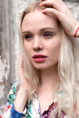 highkey: Young european blond woman outdoors portrait. Bright white colors.