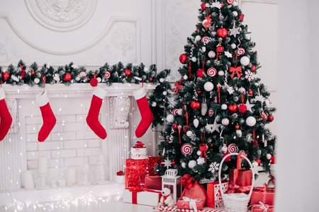 modern living room: Decorated Christmas room with beautiful fir tree, new year background Stock Photo