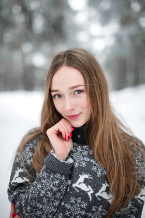 head scarf: Winter portrait of young beautiful brunette woman wearing sweater. Snowing winter beauty fashion concept.