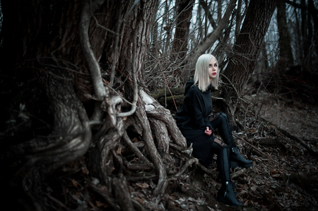 Shot of a gothic woman in a forest. Fashion.