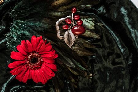 Vintage metal colorful brooch on velvet background