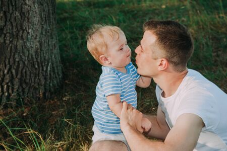 Little boy 1 year old with his father playing