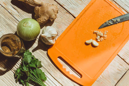 Food ingridients: red beans, carrot, cabbage, meat, onion, ginger for recipe stewed beans with meat on wooden background. Steps in cooking, process of preparing food. Concept of homemade healthy food. Flatlay, top view