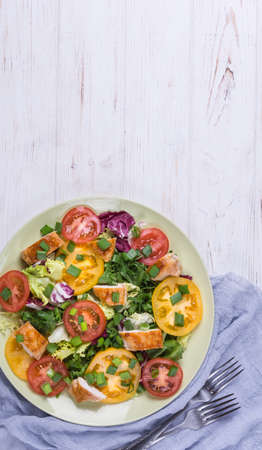 Vegetable salad with grilled chicken on white background