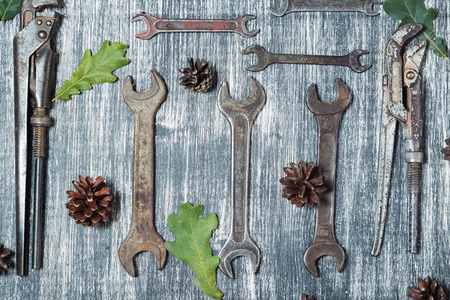 Different old vintage tools on a black and white wooden background